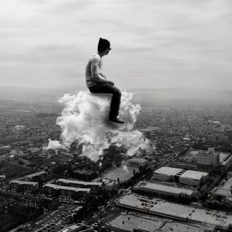 man-sitting-on-a-cloud